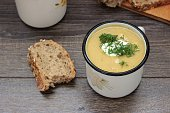 Lentil cream soup with cream cheese and dill in mug