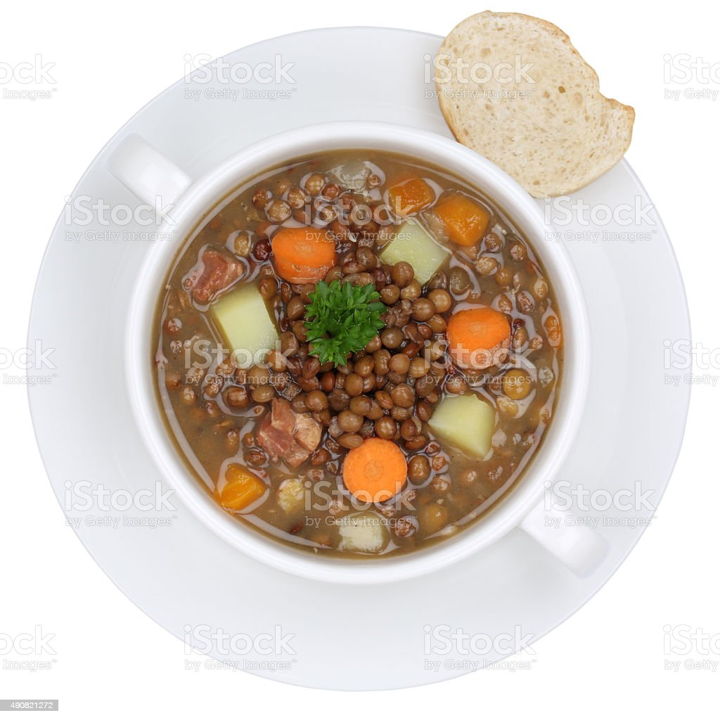 Lentil soup stew with lentils in bowl from above isolated stock photo