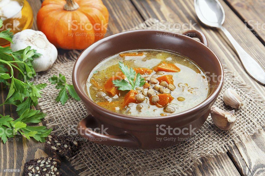Lentil soup with pumpkin stock photo