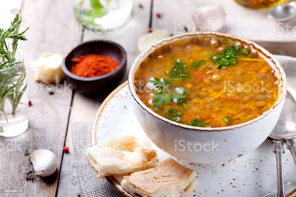 Lentil soup with smoked paprika and bread stock photo