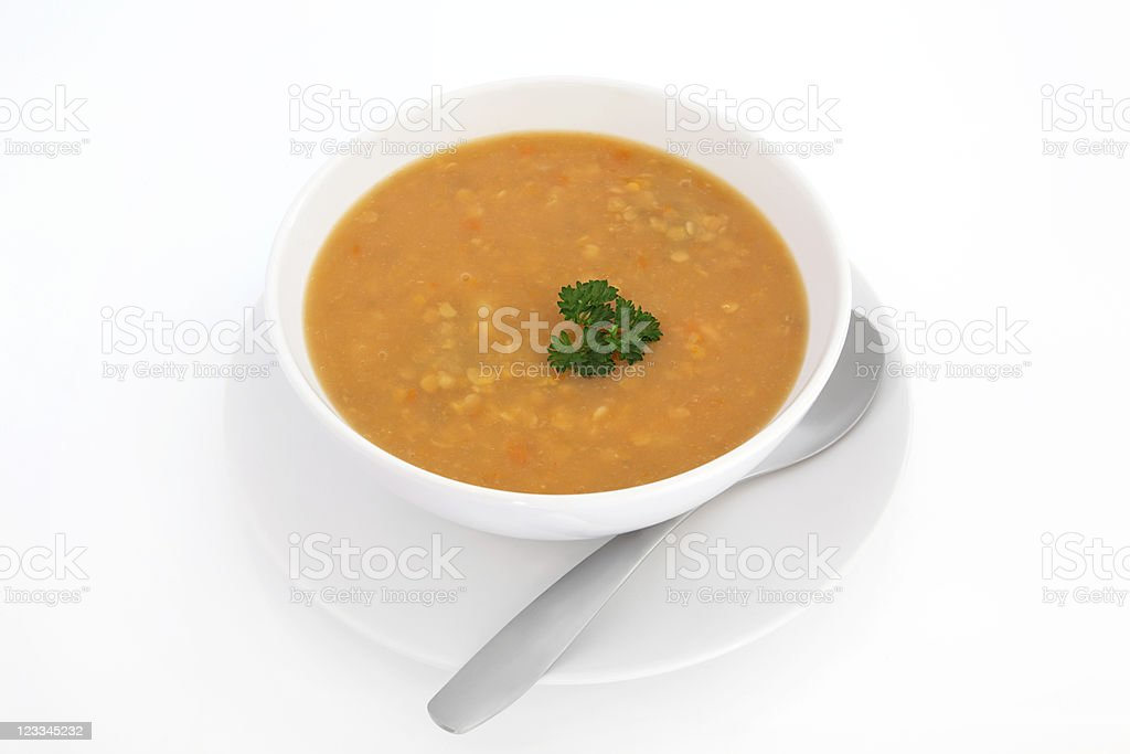 Lentil soup with spoon in white bowl stock photo