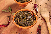 Lentil stew, shot with bay leaves and chili peppers