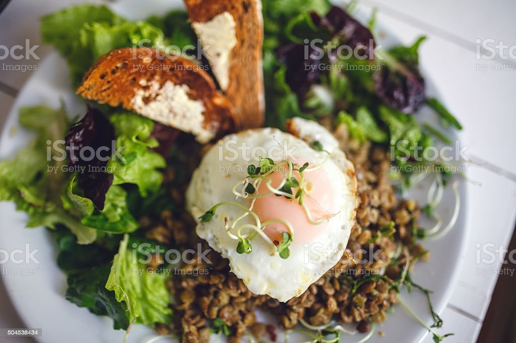 Lentils and poached egg stock photo