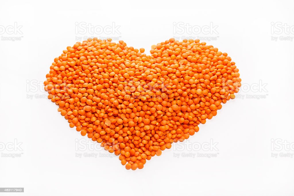 Lentils in the shape of a Heart isolated stock photo