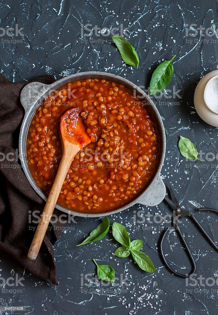 Lentils in tomato sauce in the pan. Vegetarian lentil bolognese stock photo