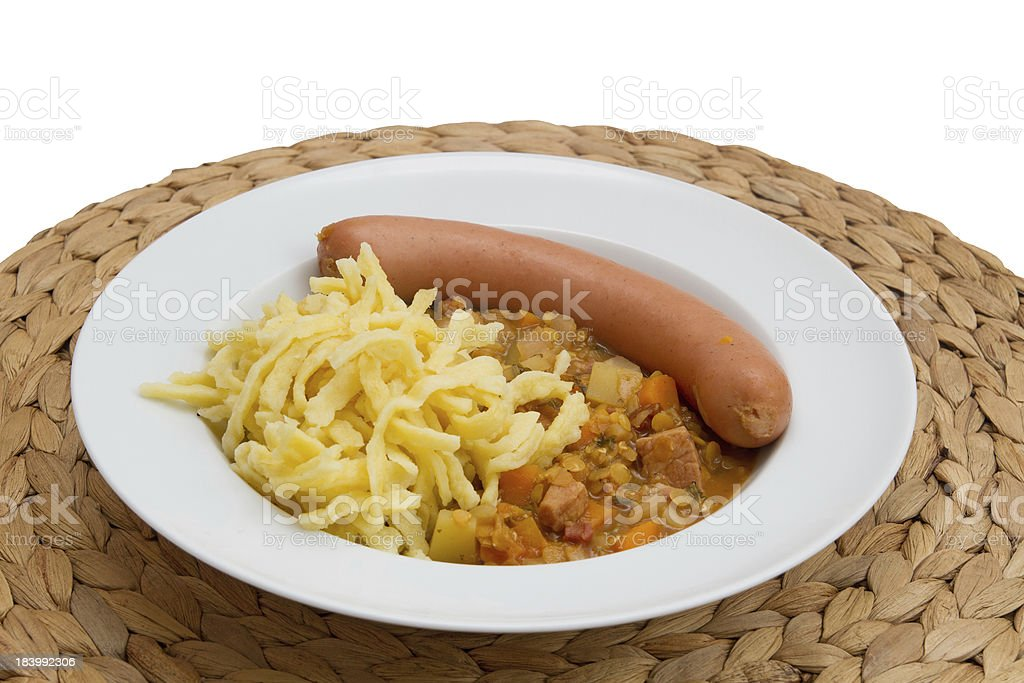 Lentils with spaetzle (noodles) and frankfurter royalty-free stock photo