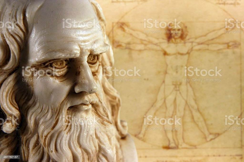 Leonardo da Vinci statue and drawing in background stock photo