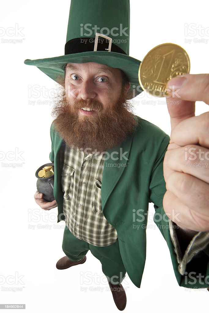 Leprechaun and one chocolate hrivna stock photo