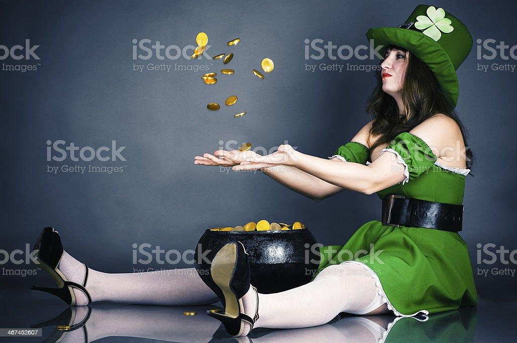 leprechaun gold coin throws up stock photo