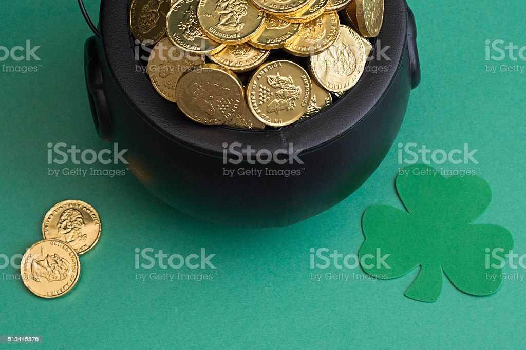 leprechaun gold for saint patricks day in black pot stock photo