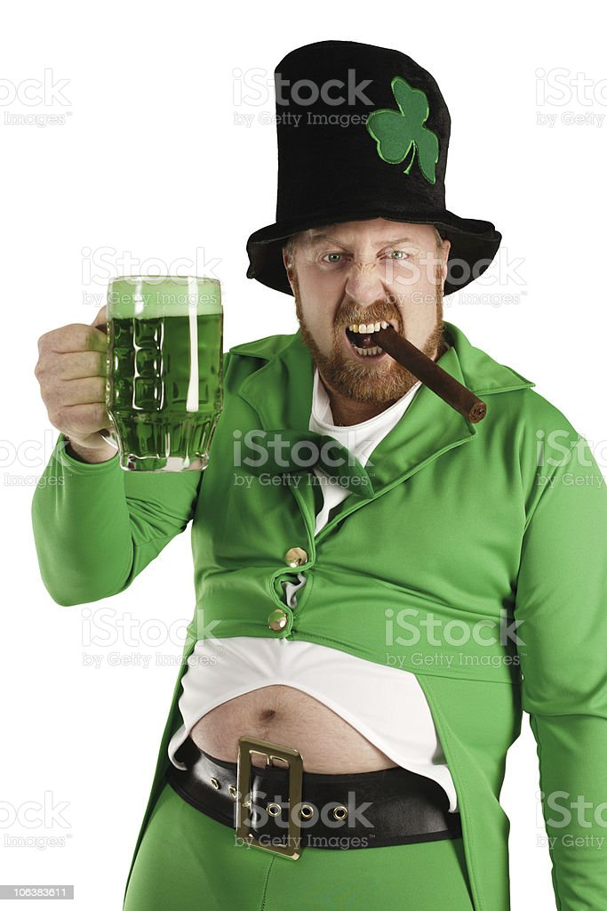 Leprechaun hoisting a green beer stock photo