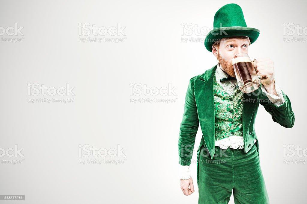 Leprechaun Man with Beer stock photo