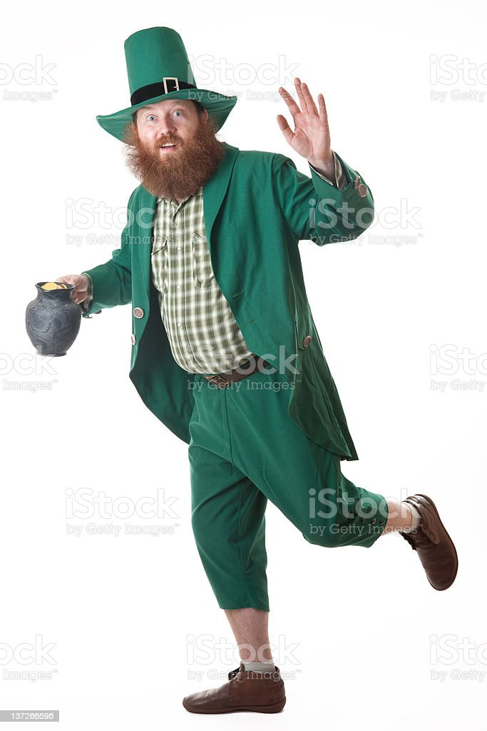 Leprechaun with coins and pot of gold royalty-free stock photo