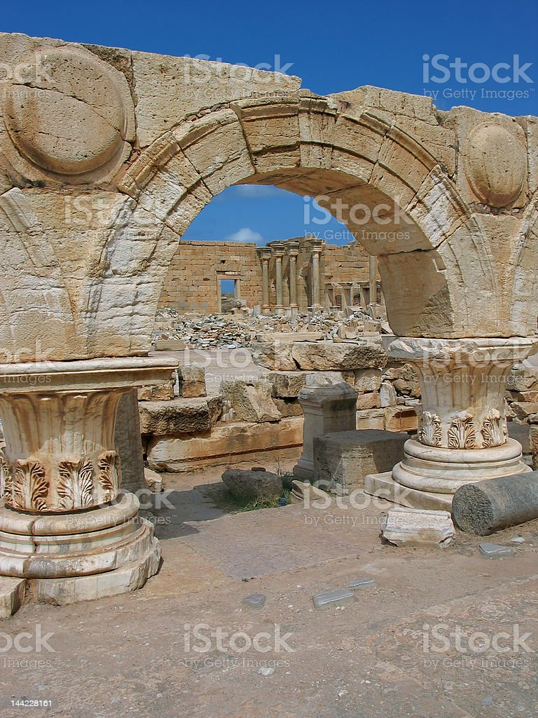 Leptis Magna - colonnade with arches of the Severan Forum royalty-free stock photo