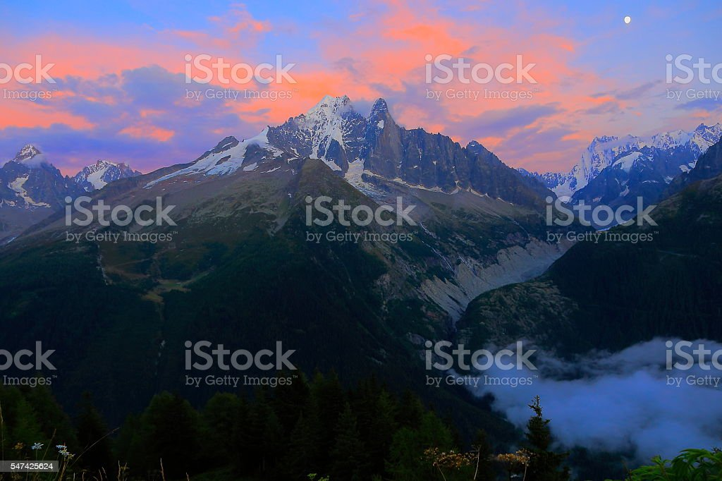 Les Drus Grandes Jorasses dramatic colorful sunset, Mont Blanc Massif stock photo
