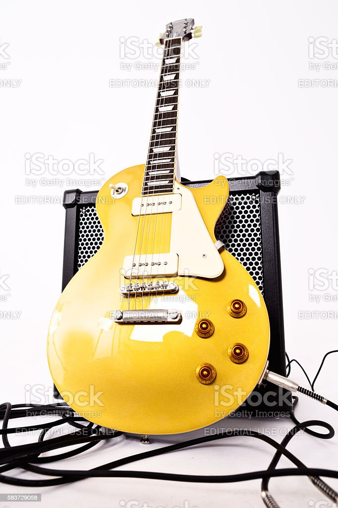 Les Paul Pro electric guitar, goldtop finish, with Roland amplifier stock photo