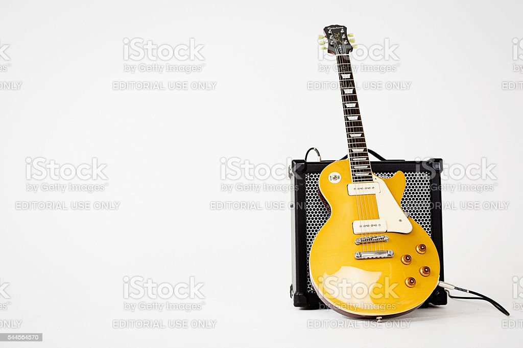 '56 Les Paul Pro electric guitar leaning on Roland amp stock photo
