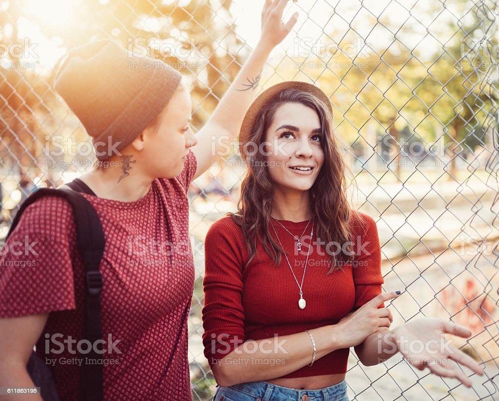 Lesbian couple flirting outside stock photo