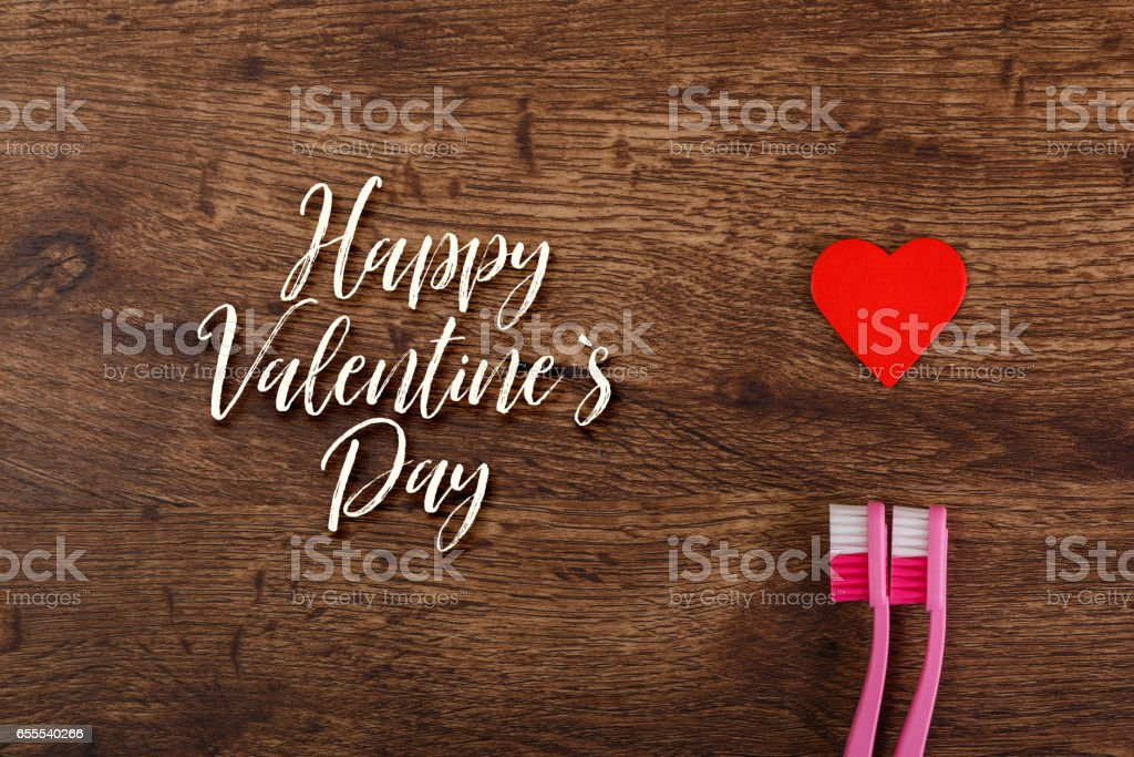 Lesbian couple love with heart and toothbrushes. stock photo