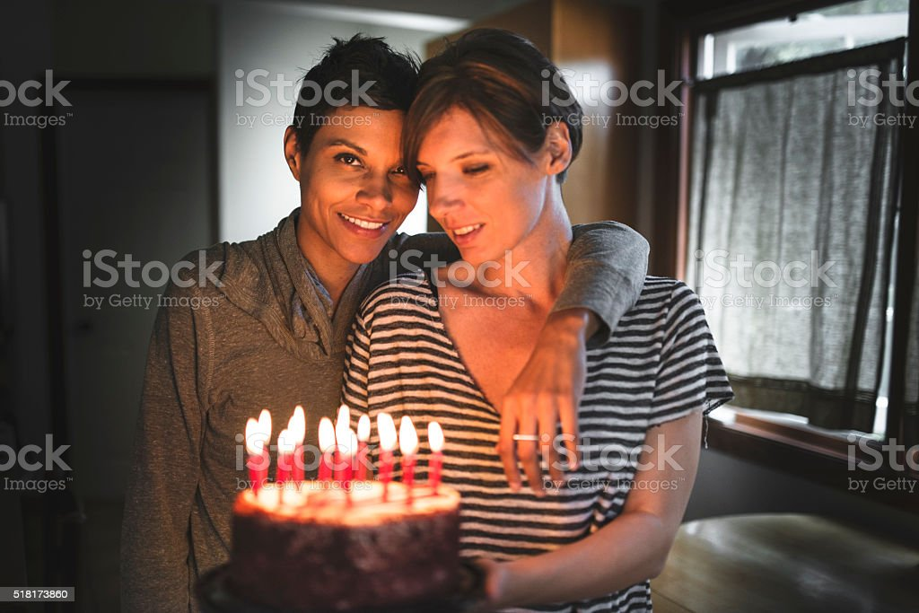 lesbian couple share the kiss for the birthday stock photo