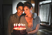 lesbian couple share the kiss for the birthday