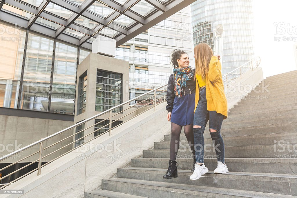 Lesbian couple walking in Berlin stock photo