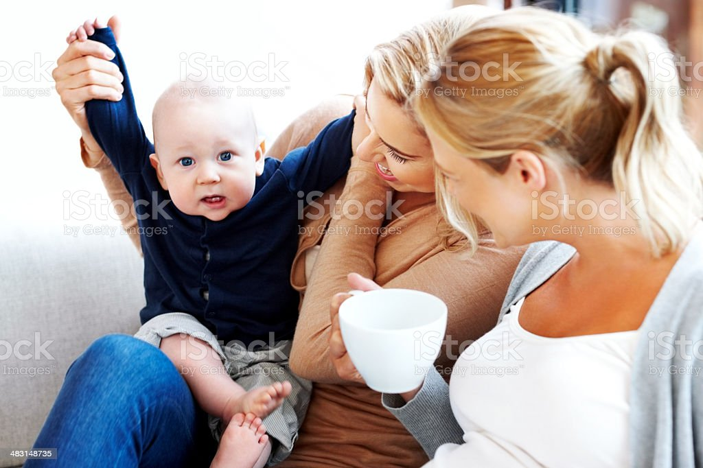 Lesbian couple with their kid having fun at home royalty-free stock photo