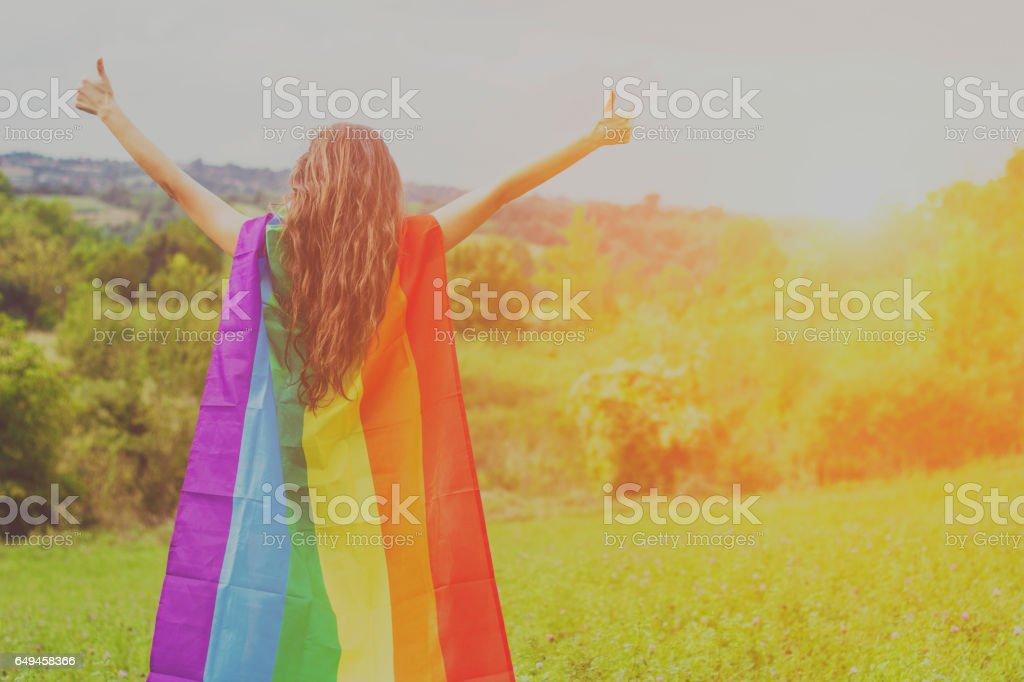 Lesbian Girl Holding LGBT Flag stock photo