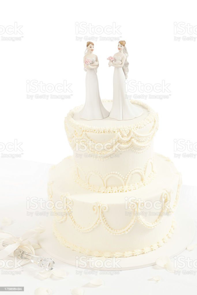 Lesbian Wedding Cake with Figurine Topper on White Background royalty-free stock photo