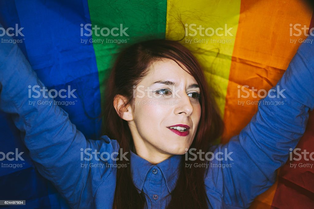 Lesbian Woman in Colorful Rainbow Background stock photo