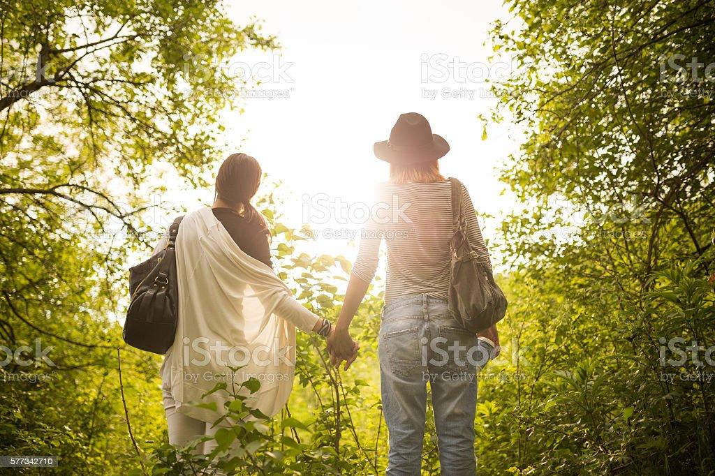 Lesbian women holding hands stock photo