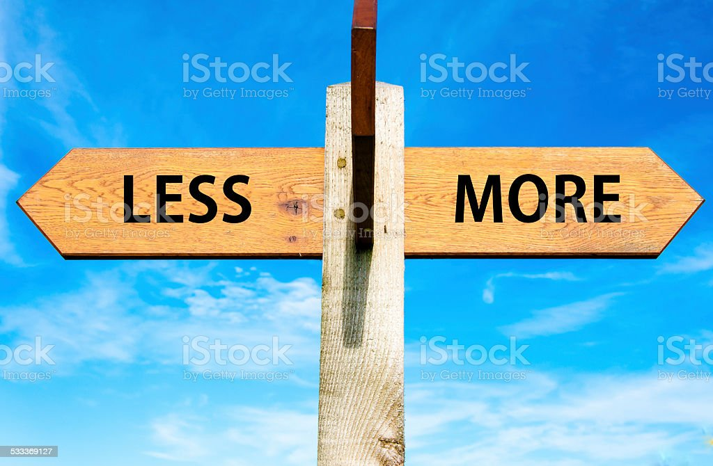 Less versus More stock photo