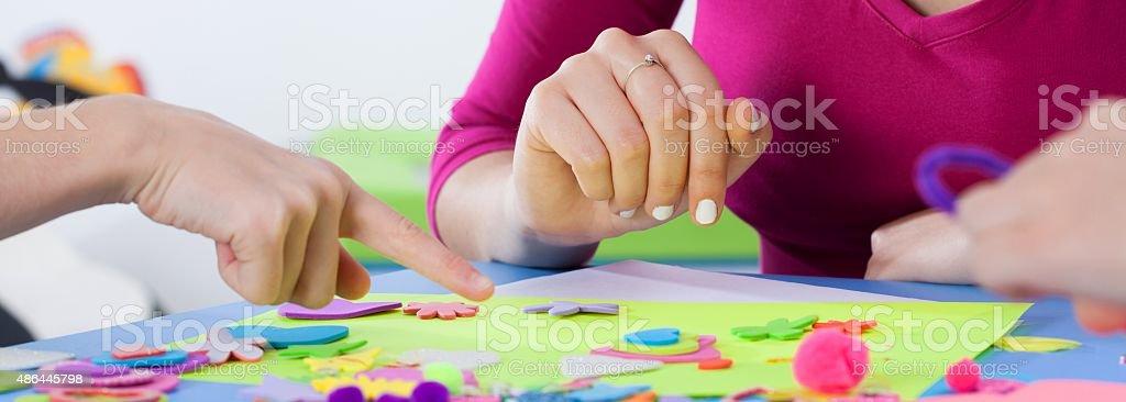 Lesson with creative teacher at kindergarten stock photo