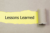 lessons learned written under torn paper