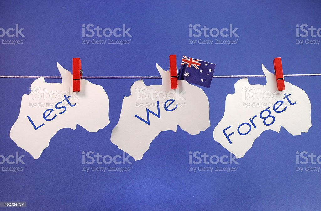 Lest We Forget message across pegs on a line stock photo