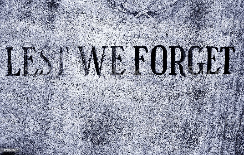 Lest We Forget written on a memorial stone stock photo