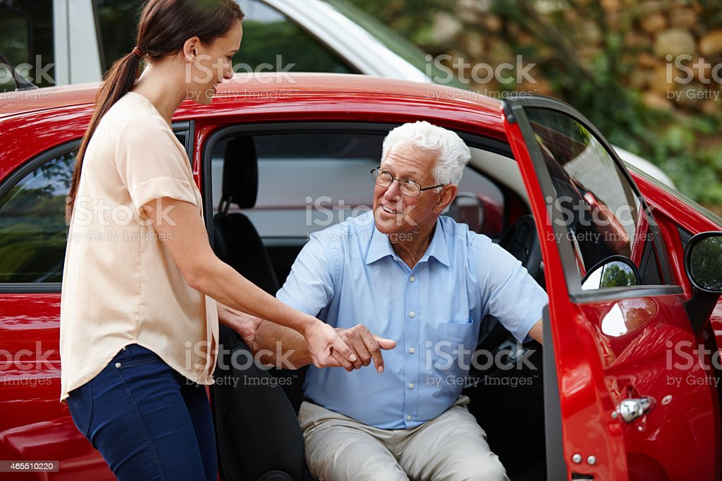Let me help you out of the car stock photo
