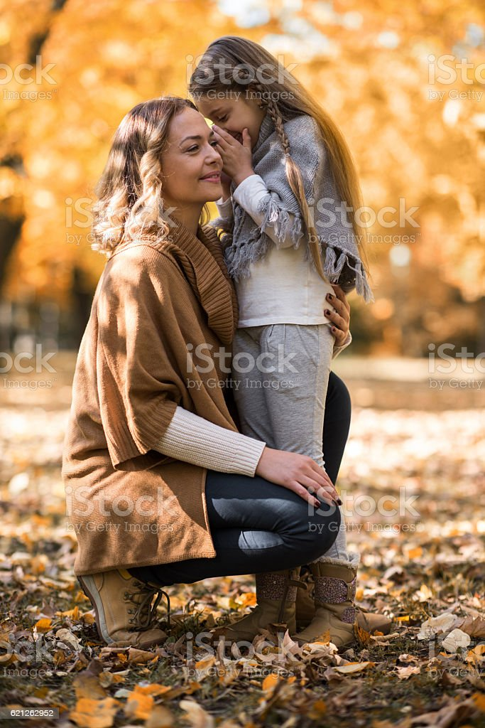 Let me tell you a secret mommy! stock photo
