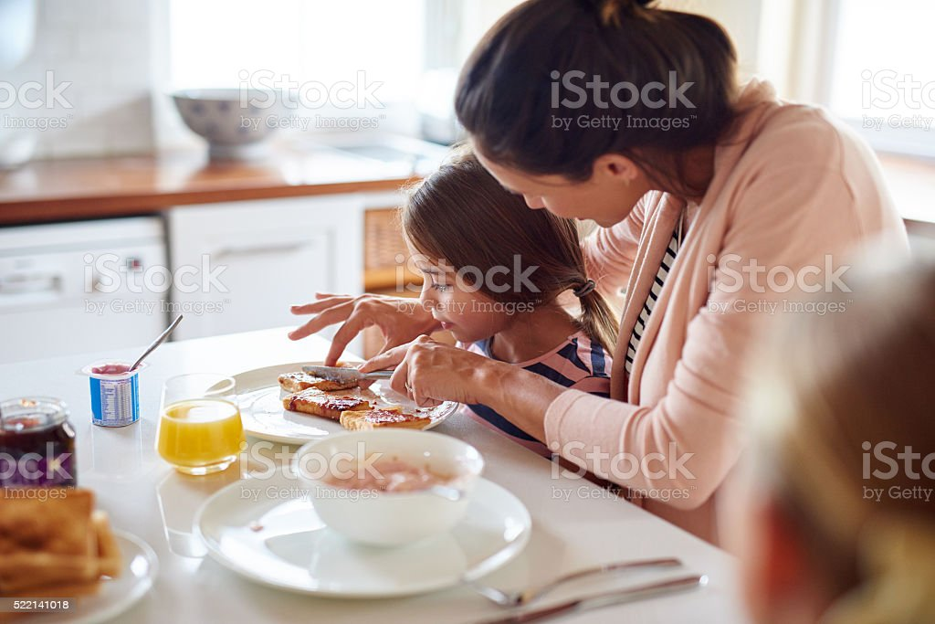 Let Mommy help you with that sweetheart stock photo