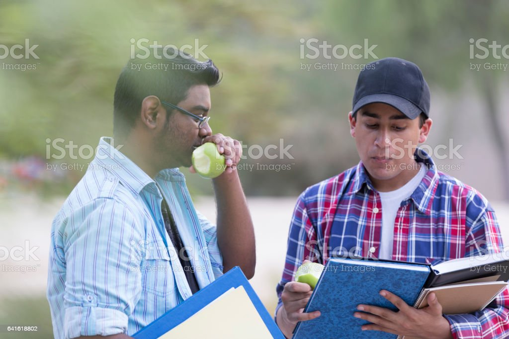 Let us multi task, we are late for our class. stock photo