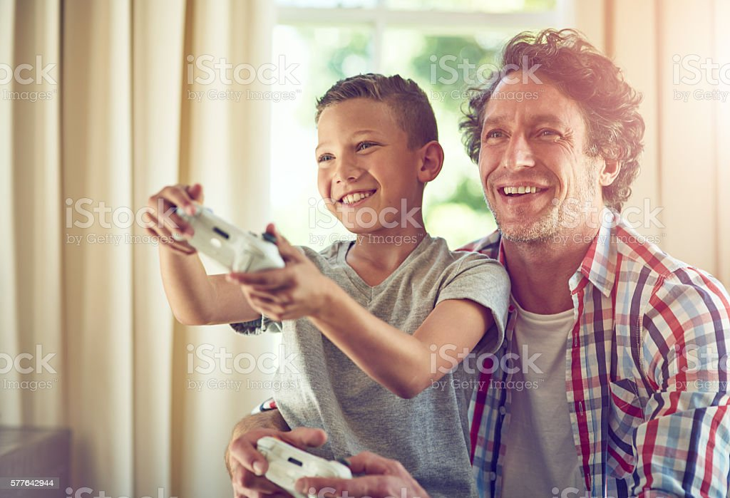 Let your father show you how it's done stock photo