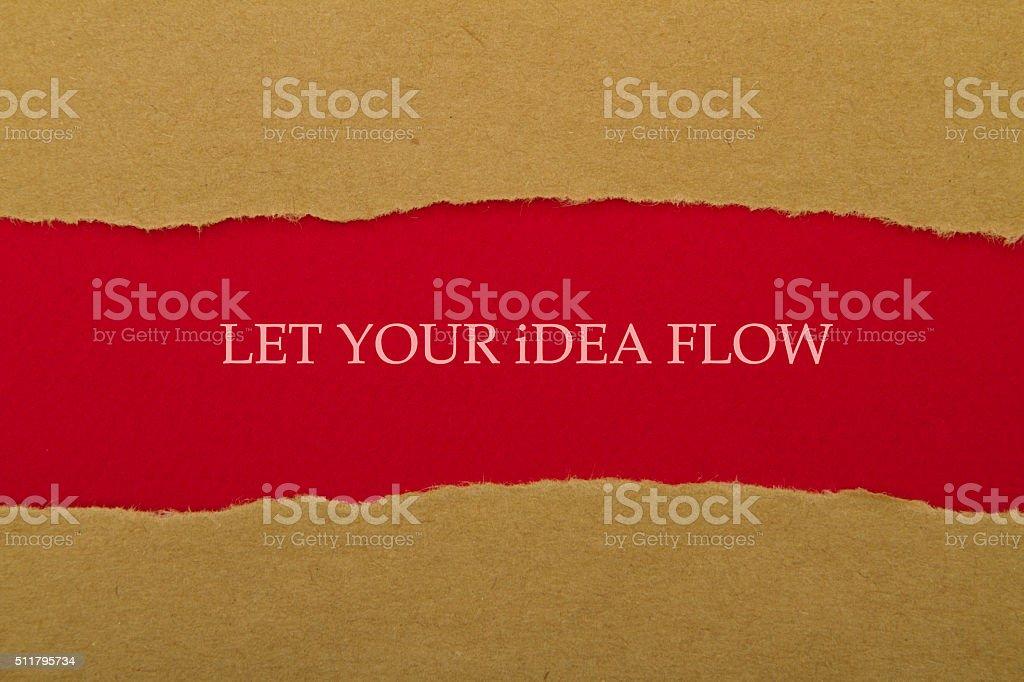 Let your idea flow message written under torn paper stock photo