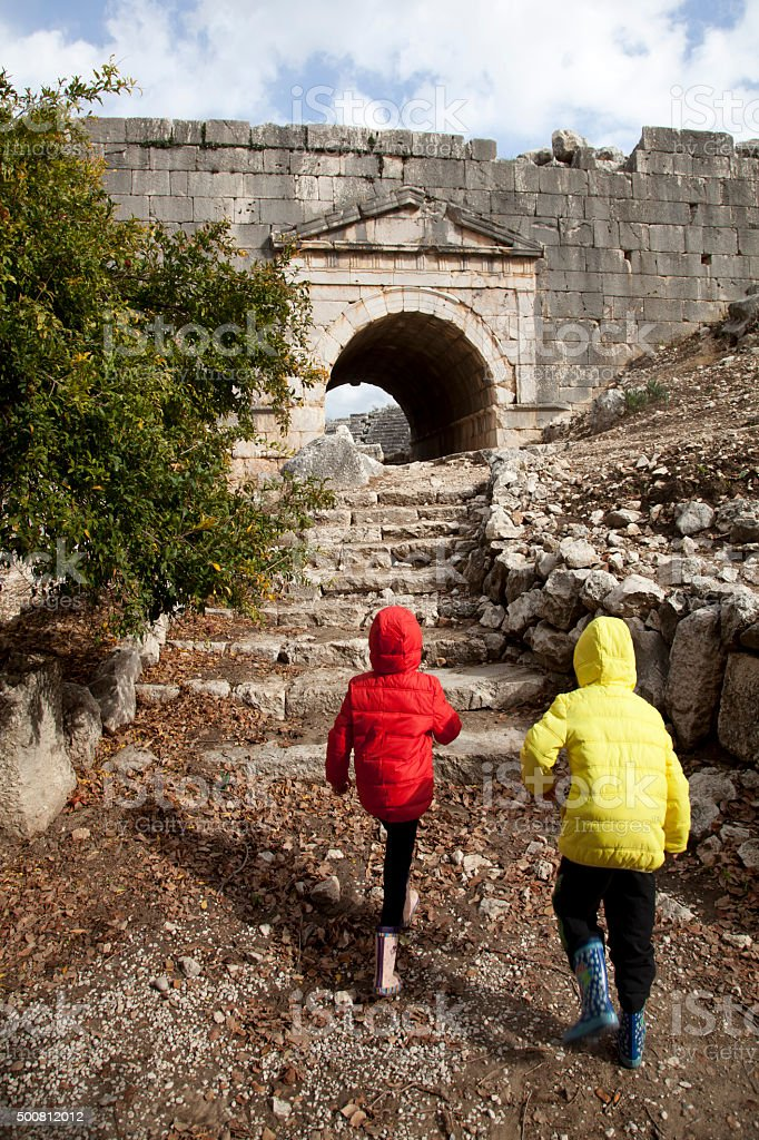 letoon ancient city with two child stock photo