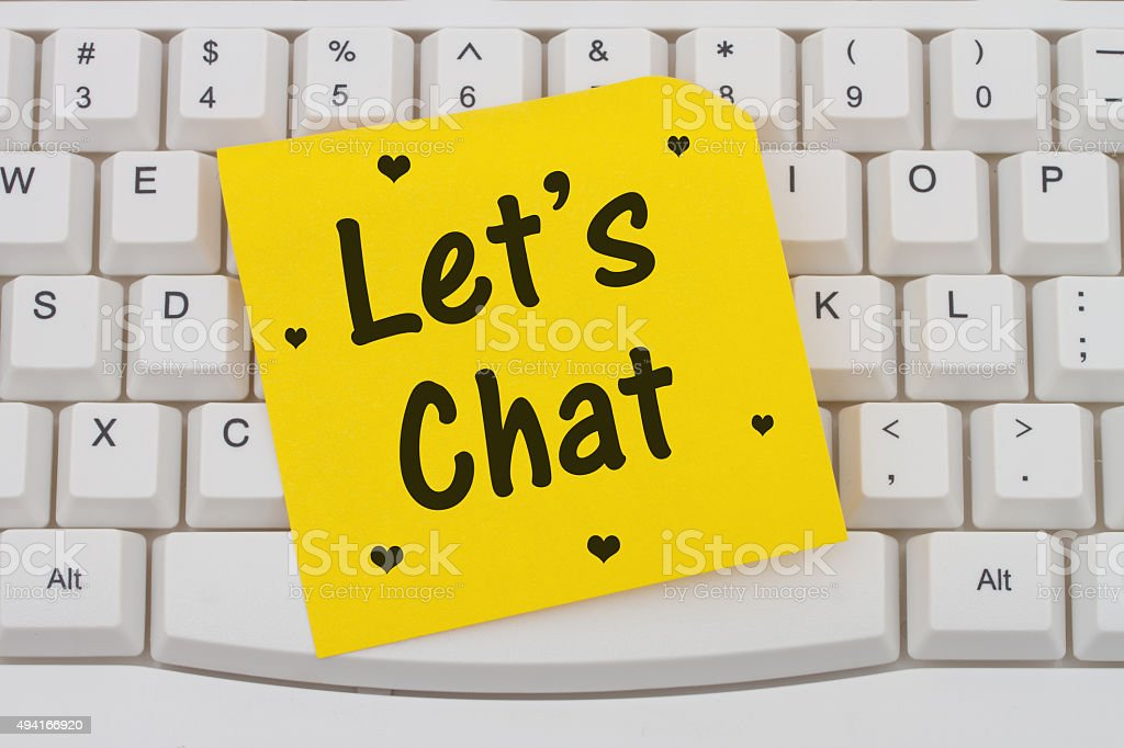 Let's Chat, computer keyboard and sticky note stock photo