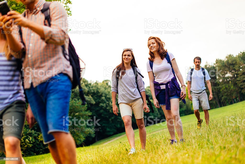 Lets find right directions for our hiking adventure stock photo