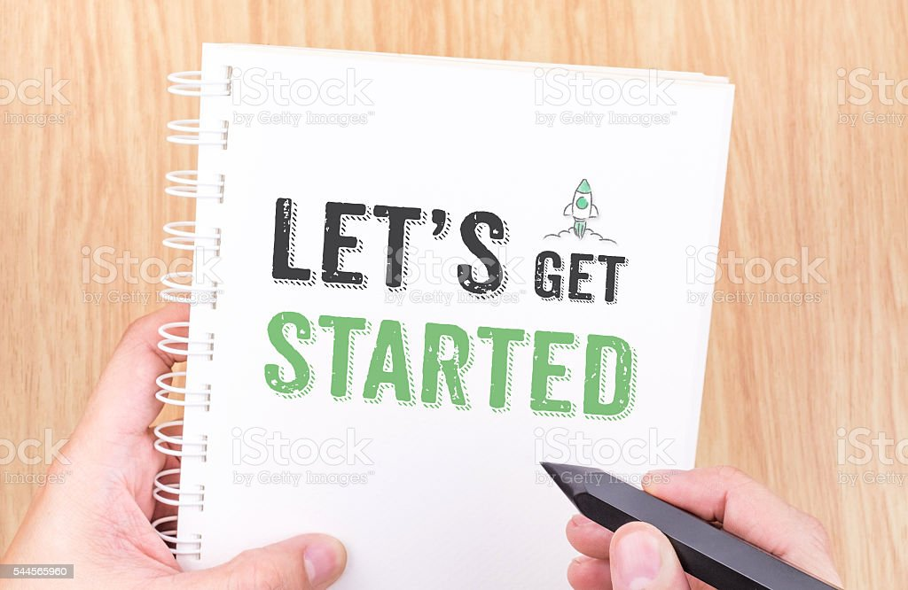 Let's get started word on white ring binder notebook stock photo