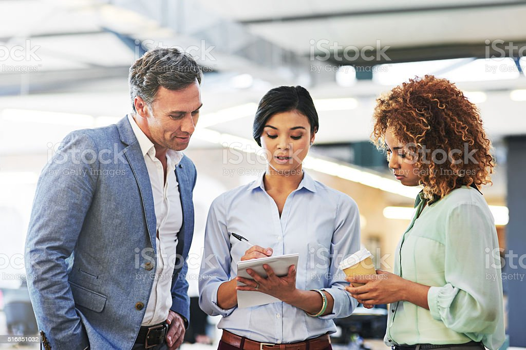 Let's go over our notes before the meeting stock photo