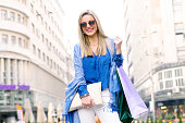 Let's go shopping - smiling young woman with shopping bags