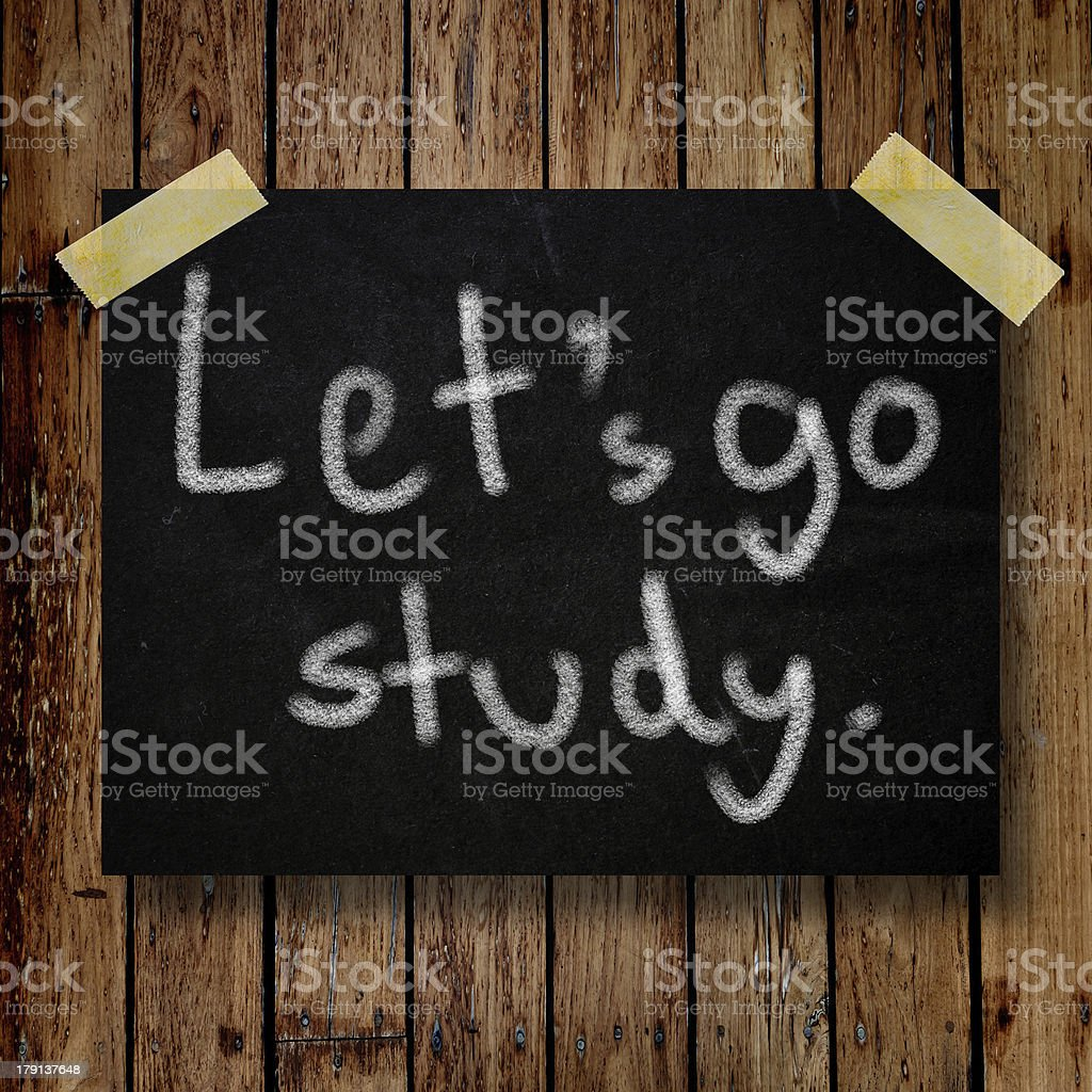 Let's go study on message note with wooden background royalty-free stock photo