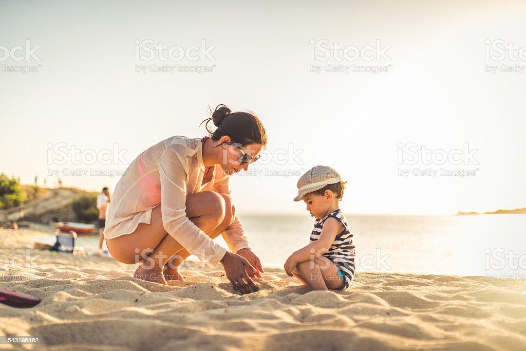 Lets make a sand castle stock photo